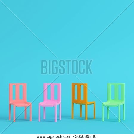 Four Colorful Chairs On Bright Blue Background In Pastel Colors. Minimalism Concept. 3d Render