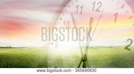Clock, grass and sky. Spring time