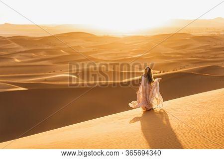 Portrait Of Bride Woman In Amazing Wedding Dress In Sahara Desert, Morocco. Warm Evening Light, Beau