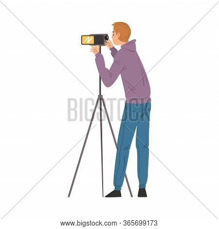 Male Video Operator Looking Through Camcorder On Tripod, Videographer With Professional Camera, Film