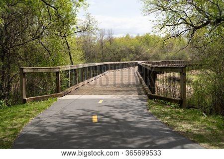 Pedestrian Bridge Over A Creek And Marsh Wetland In Elm Creek Park Reserve - Maple Grove, Minnesota