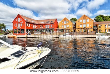 Kristiansand, Norway - July 19, 2017: Motorboats Navigate On A Canal In The Fiskebrygga District In