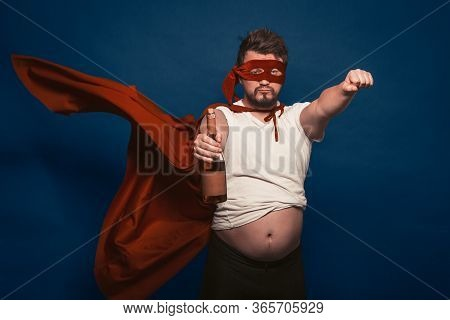 Tipsy Or Drunk Superhero Holding Bottle Of Wine, Man In Superhero Costume Ready For Feats Figurative