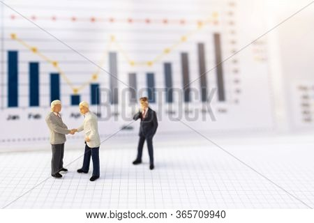 Miniature People:  Businessmen Handshake With Business Graph, Growth In Business Concept.