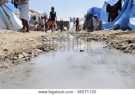Stagnant water in the tent cities.