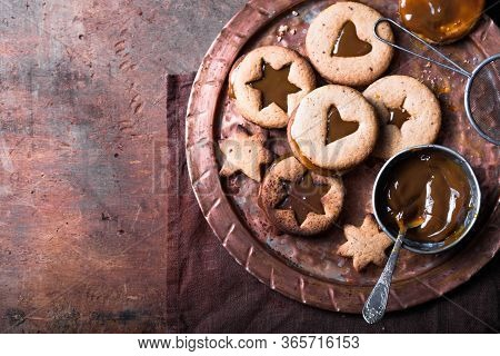 Homemade Christmas New Year Star Shape  Caramel Cookies  Over Wooden  Background. Flat Lay, Space. H