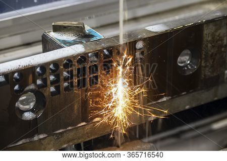 The Wire-edm Machine Cutting The Die Parts With The Sparking Light. The Mould And Die Manufacturing