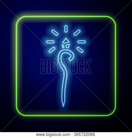 Glowing Neon Magic Staff Icon Isolated On Blue Background. Magic Wand, Scepter, Stick, Rod