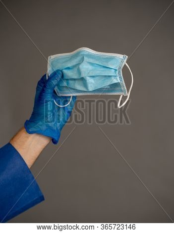 Covid-19. Doctor Or Nurse Holding Face Surgical Mask. Stop The Virus Spread, Protect Yourself And Ot