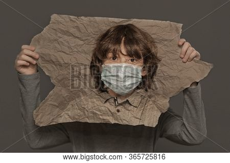 Portrait Of A Boy On Crumpled Paper In Surgical Mask. Creative Double Exposure Effect.