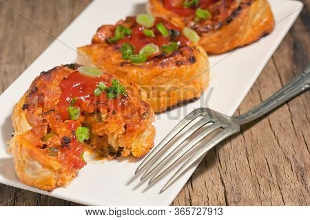 Filling Meat And Cheese Pastries On Plate In Studio