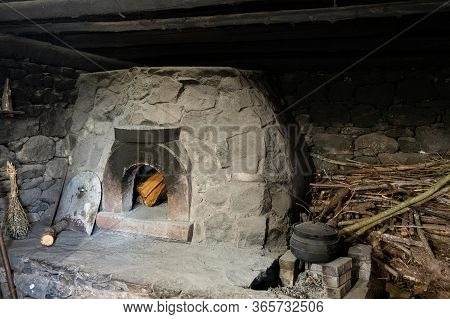 Stone Hearth Inside An Old Peasant's Home.