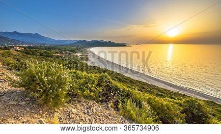 Golden Sunset Over Losari Beach On East Coast Of Corsica Near Ile Rousse, France