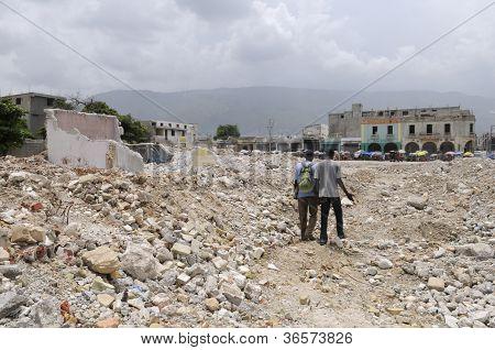 Walking on the rubble.