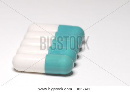 Blue And White Capsules In A Row