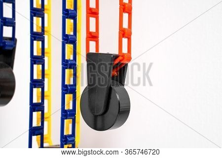 The Counterweights Of System Of Special Photographic Backgrounds Hanging From Above. Colorful Plasti