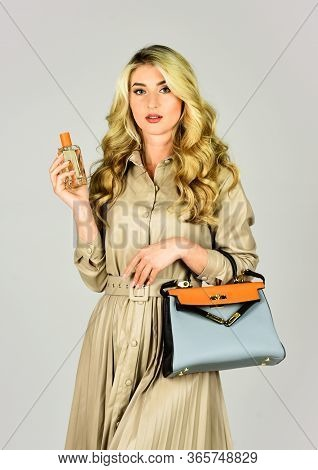 Owner Of Fragrance Is Young Modern Lady Who Keeps Up To Date. Attractive Woman Hold Perfume Bottle.