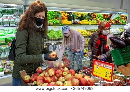 Minsk, Belarus - April 27, 2020: Buyer In Mask And Protective Gloves Buying Food In Shop At Coronavi