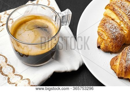 A Cup Of Espresso On A Cotton Serviette, Buttery Croissants On A Black Background. Homemade French B