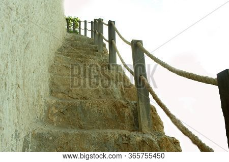 Natural Outer Coral Reef Stairs With Wooden Fence On The Cliff On White Background. Stairs To Heaven
