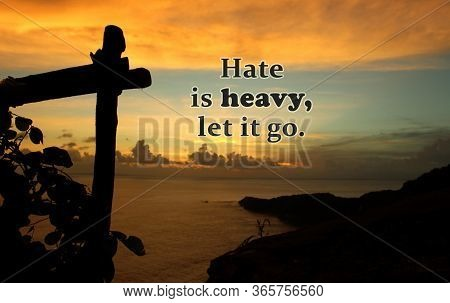 Inspirational Quote - Hate Is Heavy, Let It Go.. On Natural Abstract Background Of Dramatic Colorful