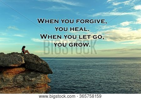 Inspirational Quote - When You Forgive, You Heal. When You Let Go, You Grow. On Blurry Background Of