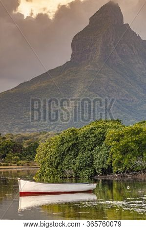 Boat In Tamarin Bay Sheltered By Rempart Mountain, Black River District, Mauritius