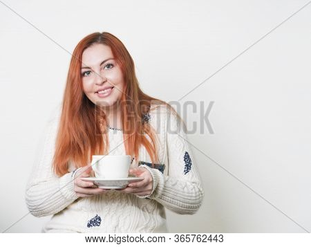 A Woman With Freckles Drinking Coffee Or Tea