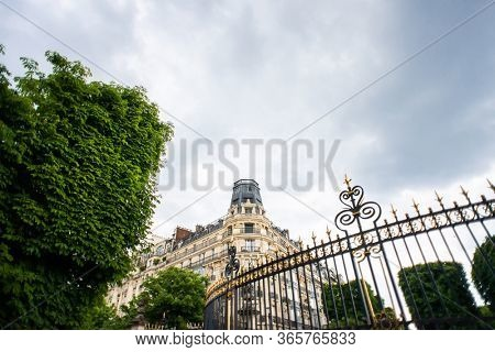 Paris. France - May 17, 2019: Beautiful Old Building Located at the Crossroads of Rue Auguste Comte and Avenue de L' Observatoire Streets in Paris, France. Entrance Gate of Luxembourg Gardens.