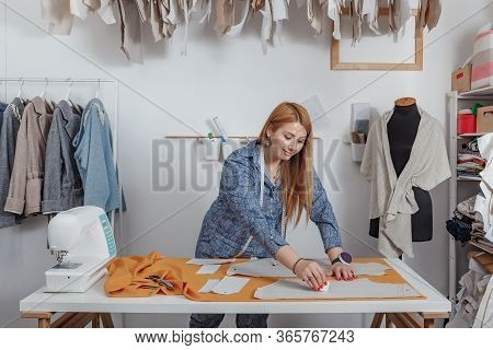 A Fashion Designer, A Young Woman, Creates A Mould And Draws A Uniform, Works In The Studio, Creatin