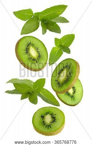 Flowing Kiwi Fruit Amd Mint Isolated On White Background With Shallow Depth Of Field