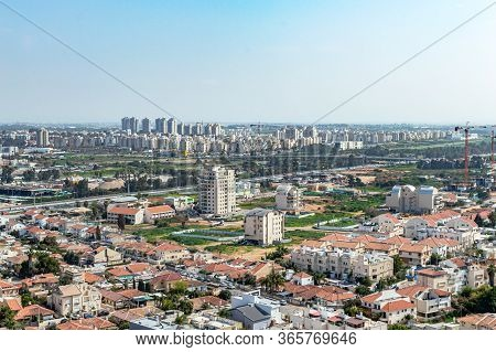 City With Private Houses And High-rise Buildings On A Background Of Sky