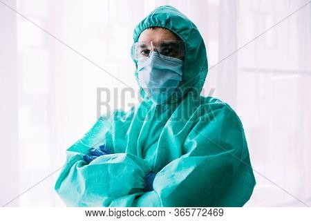 Man doctor or scientist waring protective suit, and face mask