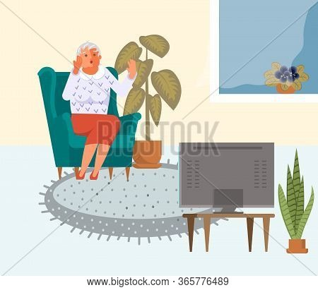 Old Woman Is Watching The News While Sitting In The Armchair And Feels Reimbursement And Anger. Toxi