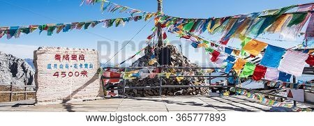 Prayer Flags And Stupa At The Peak Of Shika Snow Mountain Or Blue Moon Valley In Zhongdian City (sha