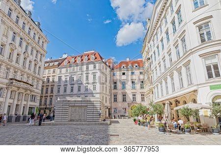 Vienna, Austria September 7, 2018: People Walking By Judenplatz Holocaust Memorial Also Known As The