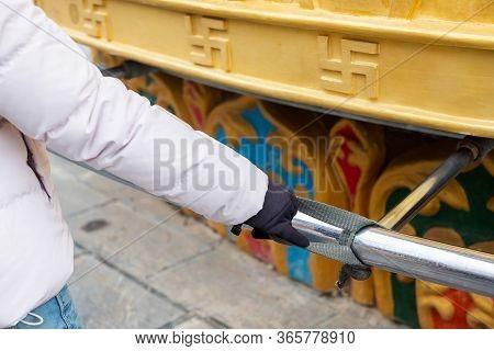 Woman Traveler Hand Spinning Giant Golden Wheel In Shangri-la Golden Temple Or Dafo Temple At Dukezo