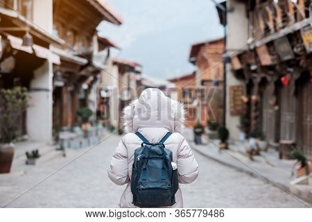 Young Woman Traveler With Sweater Traveling In Dukezong Old Town, Located In Zhongdian City (shangri