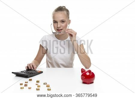 Children Frugal Concepts. Blond Teenage Girl Posing With Coins And Moneybox. Calculating Income With