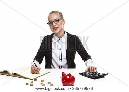 Kids Frugal Concepts. Blond Teenager Girl Posing With Coins And Piggy Bank. Storing Up Money With Mo