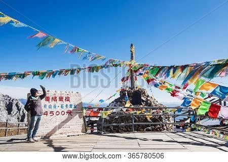 Young Woman Traveler Traveling At Shika Snow Mountain Or Blue Moon Valley In Zhongdian City (shangri