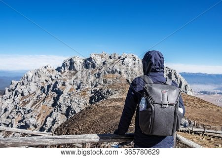 Young Man Traveler Traveling At Shika Snow Mountain Or Blue Moon Valley, Landmark And Popular For To