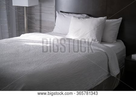 Bed In A Hotel Room In The Morning, Made Fresh With New Sheets And Blanket