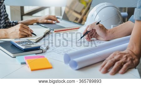 Engineer Hand Drawing Plan On Blue Print With Architect Equipment Discussing The Floor Plans Over Bl