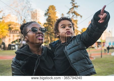 Portrait Of An African American Mother With His Son Having Some Fun Outdoors In The Park. Monoparent