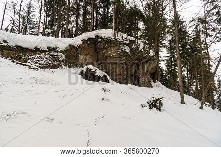 Sandstone Rock Formation In Winter Forest With Snow - Dorkowa Skala Near Przelecz Szarcula In Beskid
