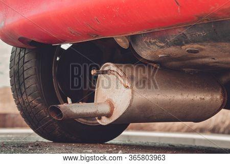 Car Exhaust (muffler) Fallen Off A Car - Forgotten Car On Street Concept