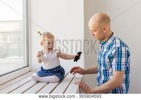 Father With His Cheerful Baby Girl Daughter. Single Parent. Fatherhood, Fathers Day And Family Conce