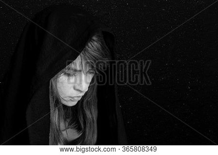 Close-up Of A Womans Face In A Black Scarf, Suffering, Sadness, Sadness. Black And White. Concept Of