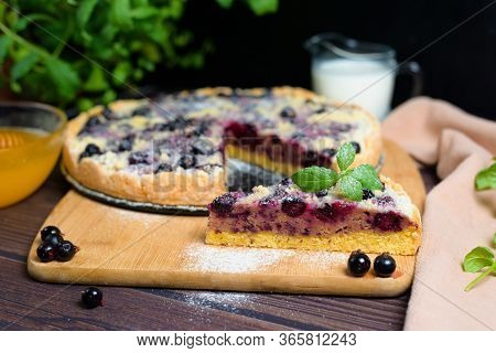 Pie With Black Currant And Shortbread, Fresh Berries. Cut Into Pieces Pie Top View Sprinkled With Po